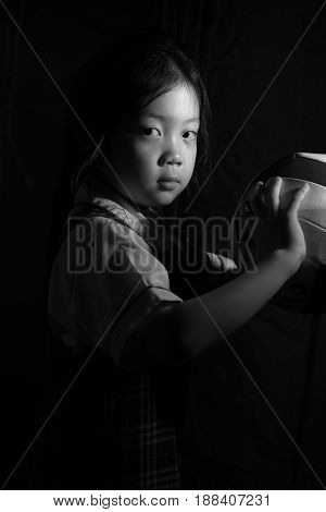 Determined Asian Child Ready For Competition In Black And White
