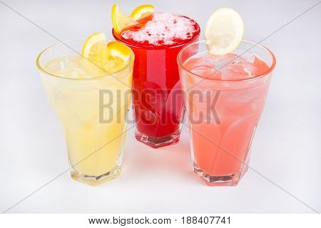 Lemonade glasses served on a white background
