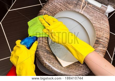 Woman In Yellow Rubber Gloves Is Cleaning Toilet Bowl