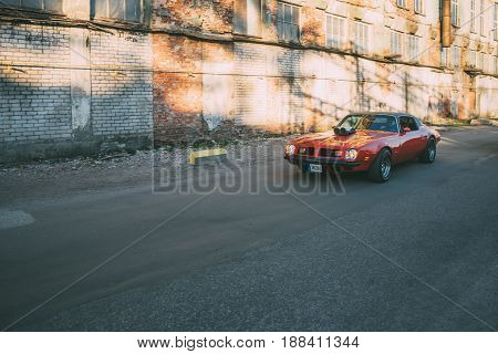 TALLINN ESTONIA - MAY 6 2017: American Beauty Car Show in motion 1975 Pontiac Firebird on street of Kalamaja district.