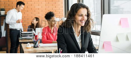 Businesswoman working in creative office with multiethnic colleagues panoramic banner