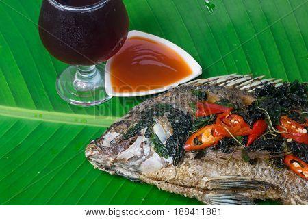Fried fish (Tilapia) isolate banana leaf,thai food