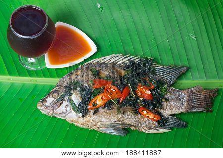 Fried fish (Tilapia) isolate banana leaf,thai foog