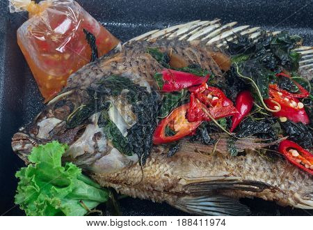 Fried fish (Tilapia) in foam box,thai food