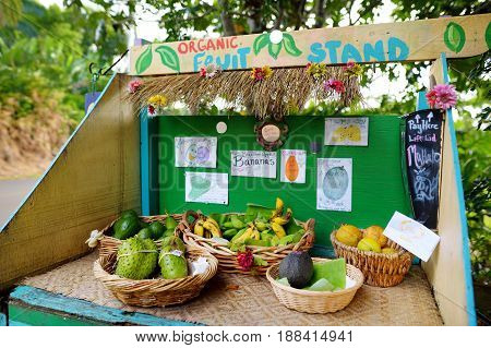 Avocados, Lemons, Bananas And Other Fruits For Sale At A Self Service Roadside Stand On The Big Isla
