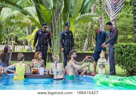 KOH PHANGAN THAILAND - NOVEMBER 13 2016 : Police came to check the order of a private villa before full moon party. Unidentified people arrived on the Koh Phangan to participate in Full Moon party