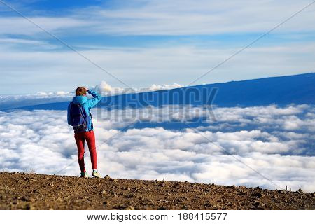 Tourist Admiring Breathtaking Views From The Mauna Kea, A Dormant Volcano On The Island Of Hawaii