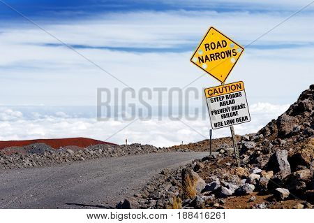 A Road Sign On A Steep Road To The Summit Of Mauna Kea, A Dormant Volcano On The Island Of Hawaii