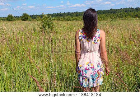 Girl in pink dress in russian field