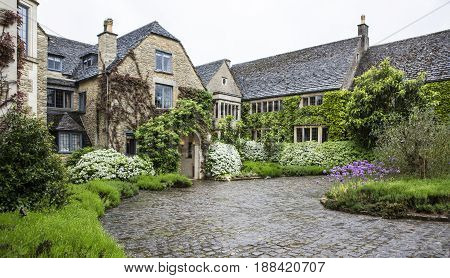 MALMESBURY UK - MAY 16 2017: The Courtyard Entrance at Whatley Manor in The Cotswolds near Malmesbury Wiltshire England UK