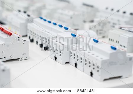 many residual current devices standing in a row on the table
