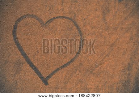 Heart on the old wood and dusty.