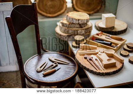 vintage looking wood carver's work place with instruments and wood cuts