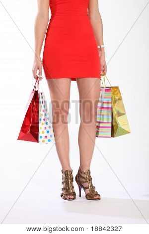 Sexy Legs And Heels Of Woman With Shopping Bags
