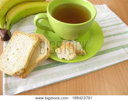 Tea, twice baked crisp bread and banana