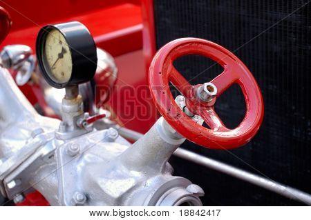 Closeup of antique red fire engine valve