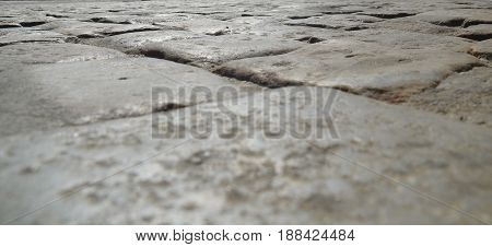 Old stones road pavement close view background