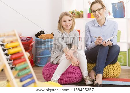 Child Psychologist And Little Girl
