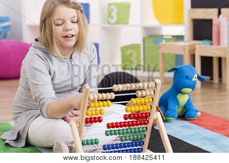 Genius Girl Playing With Abacus