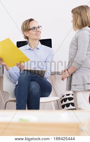 Child Talking With Speech Therapist