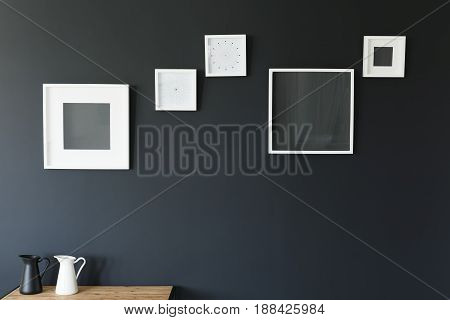 Frames And Jugs On Table