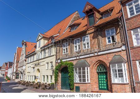 LUNEBURG, GERMANY - MAY 21, 2017: Street with historic houses and restaurant in Luneburg, Germany