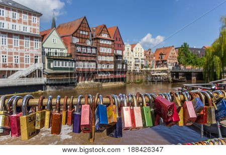 LUNEBURG, GERMANY - MAY 21, 2017: Love locks attached to the bridge in the old harbor of Luneburg, Germany