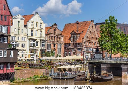 LUNEBURG, GERMANY - MAY 21, 2017: People enjoying the sun in the historic harbor of Luneburg, Germany