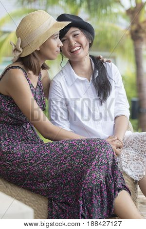 young asian woman and lovely friend smiling talking
