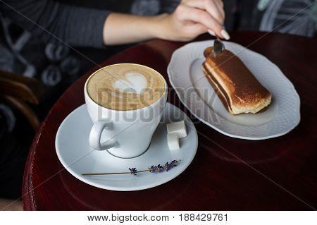 Cup Of Coffee With Foam And Tiramisu Cake