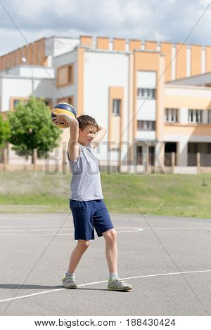 Teenager In A T-shirt And Shorts Playing With A Ball
