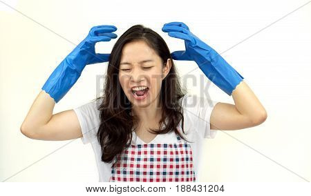 Asian woman screaming and stress from doing housework chores