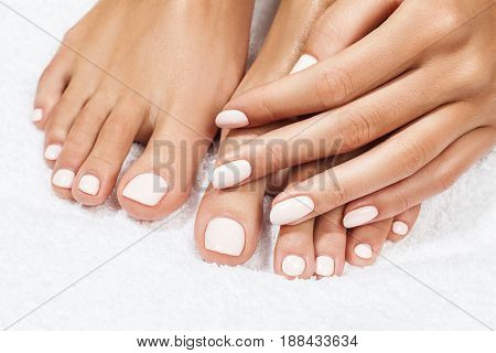 Beautiful female feet over white background. Close-up. Legs care concept.