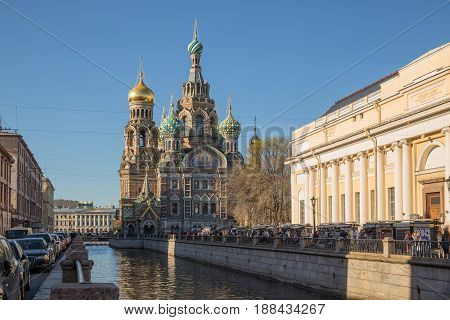 SAINT-PETERSBURG RUSSIA - MAY 16 2017: Souvenir market near the Cathedral of the Savior on Blood on the Griboyedov Canal St. Petersburg Russia