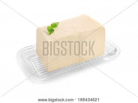 Dish with butter on white background