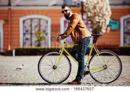 Handsome Bearded Young Man In Sunglasses On Bike In The City. Bicycle Concept