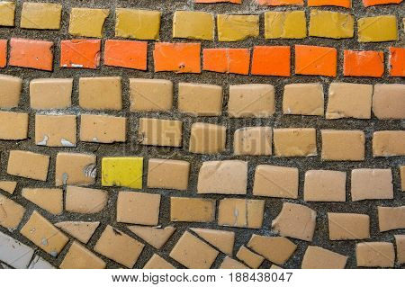 Close up bright yellow and orange tiles for background texture