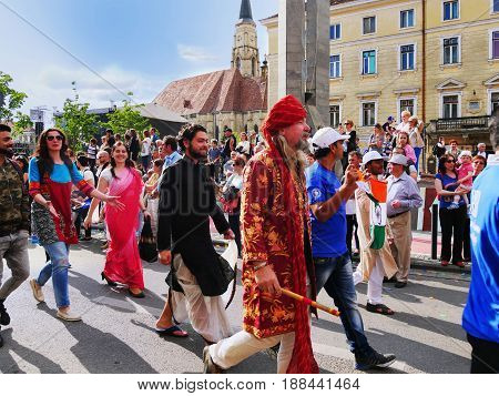 CLUJ-NAPOCA ROMANIA - MAY 27 2017: Indian group of people march on the streets waving the Indian flag at the opening parade of the Cluj Days festival.