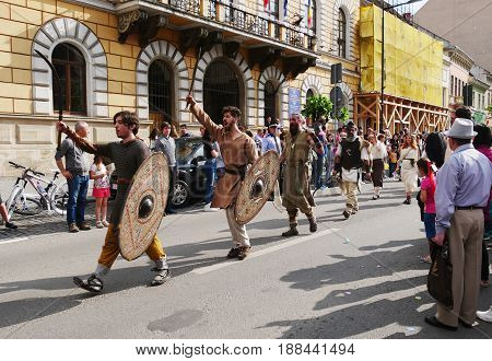 CLUJ-NAPOCA ROMANIA - MAY 27 2017: Warriors with beautiful old shields and sword march on the streets at the opening parade of the Cluj Days festival.