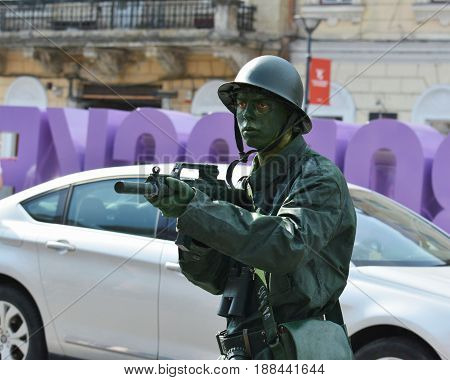 CLUJ-NAPOCA ROMANIA - MAY 27 2017: Young man disguised as world war two soldier holds a bayonet in his hand at the opening parade of the Cluj Days festival