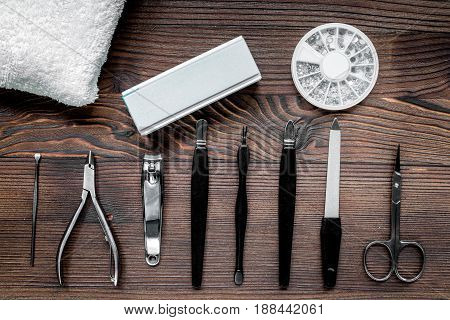manicurist work place with manicure set for hands care on wooden background top view