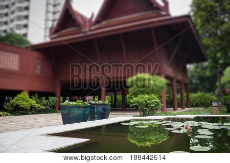 Lotus Pond In Front Of Traditional Garden stock photo