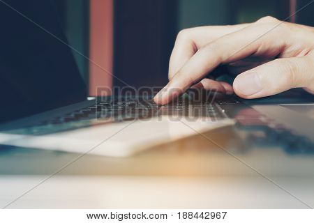 Woman Hand Typing Keyboard Laptop And Credit Card With Shopping Online Concept.