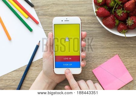 Alushta Russia - May 23 2017: Woman holding iPhone with social networking service Snapchat on the screen. iPhone was created and developed by the Apple inc.