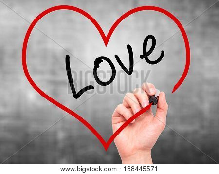 Man Hand Writing Love With Marker On Transparent Wipe Board