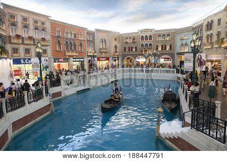 VENETIAN MACAU CHINA - AUGUST 222014 : tourist in gondola boat scene in venetian hotel most popular traveling destination