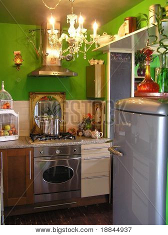 photograph of a very cozy, classy and well designed green kitchen