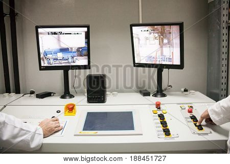 CHERNOBYL UKRAINE - OCTOBER 16 2015: Engineers monitoring nuclear reprocessing in a control room at Chernobyl Nuclear Power Plant.