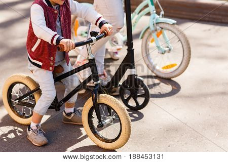 Competition of family on bicycles in spring park