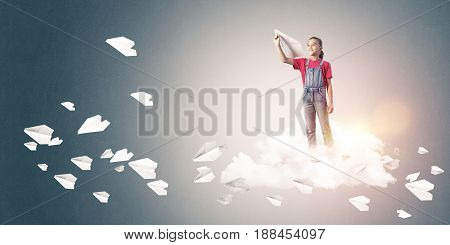 Cute kid girl on cloud and paper planes flying around